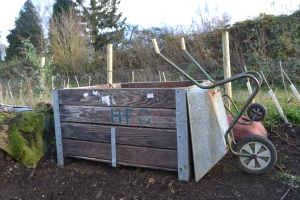 Old metre square apple crates make good compost bins, now on the NE railway border